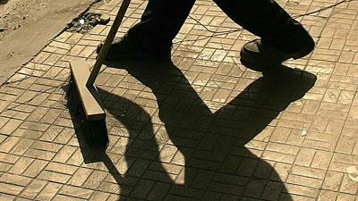 BroomShadowSweepingStreet